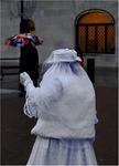 Tiggare och kvinna med paraply