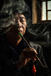 Portrait of Yao ethnic man with his pipe