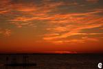Solnedgång med flotte
