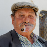 Emilio smoking cigarr.jpg